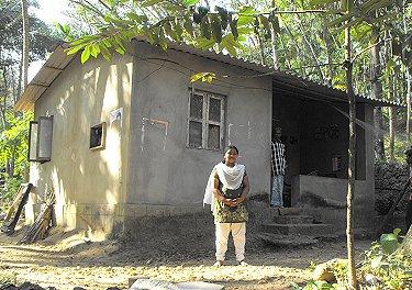 Jency Raju outside her home at Idinjar