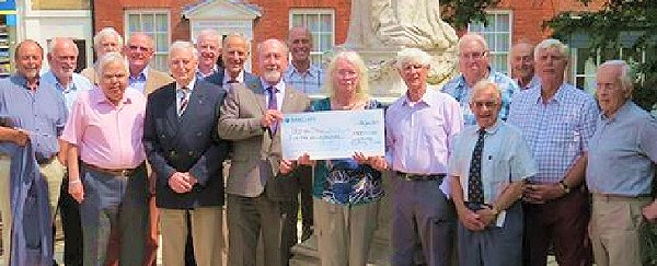 Receiving a donation from Woodbridge Rotary Club